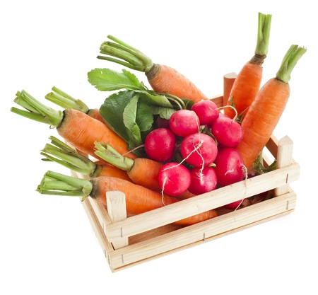 fresh vegetable, asparagus, radish, carrots in wooden crate box isolated on white background photo