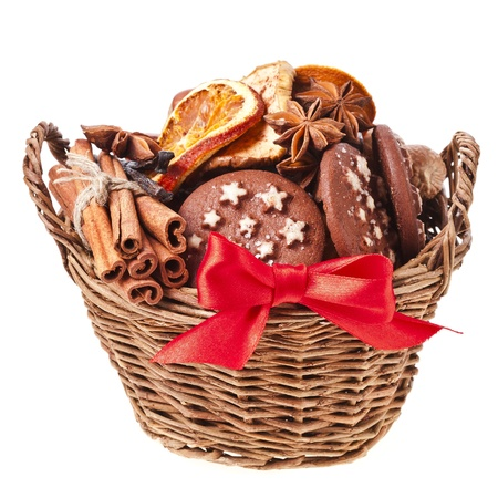 christmas basket full cookie and red ribbon bow on a white background photo