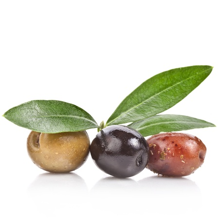kalamata: pickled olives with spices and olive tree leaves isolated on a white background