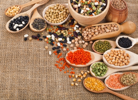 soja: different beans, legumes, peas, lentils in spoon on the sackcloth background