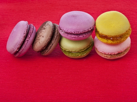 Colorful macaroons on a red background Stock Photo - 18374670