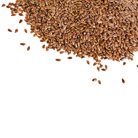 flax seed oil: border of brown flax seed linseed closeup isolated on white background Stock Photo
