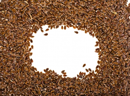 flax seed oil: border frame of flax seeds on white background with copy space