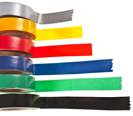Multicolored insulating tapes roll isolated on white background photo
