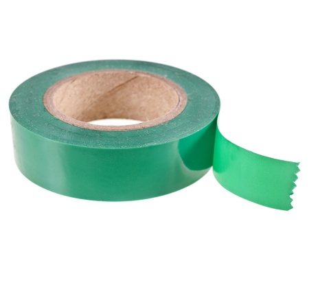 green insulating tape roll isolated on white background photo