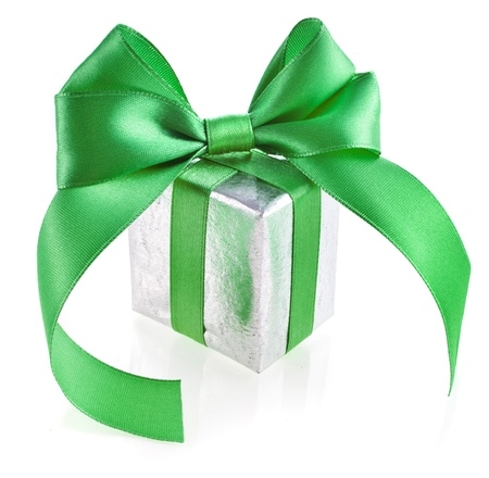 patric: gift box with green ribbon bow isolated on white