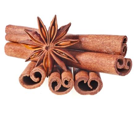 badiane: cinnamon sticks with whole star anise isolated on white background Stock Photo