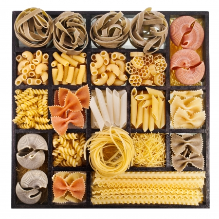 close up food: Italian pasta collection in wooden box isolated on black background Stock Photo