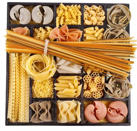 pantry: Italian pasta collection in wooden box isolated on black background Stock Photo