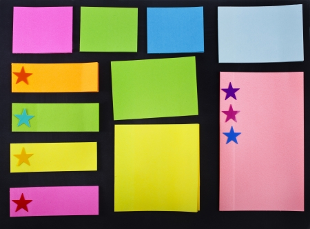 empty colored memo sticky paper notes on black background photo