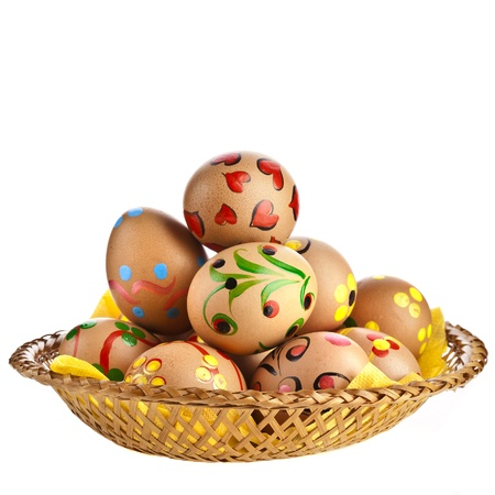 colorful easter eggs in basket dish, isolated on white background Stock Photo - 18503892