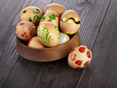easter egg in dish on black wooden background with copy space for your text Stock Photo - 18503943