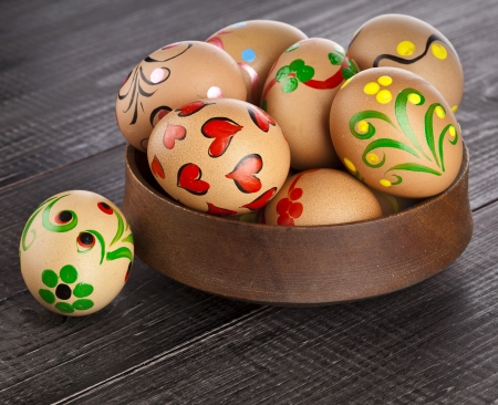 easter egg in dish on black wooden background Stock Photo - 18503965