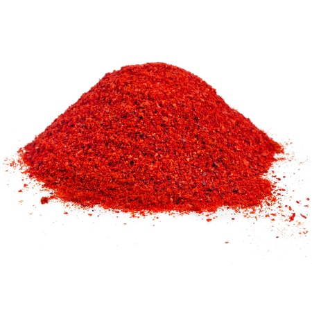 chillies: pile of ground powder paprika isolated on white background Stock Photo