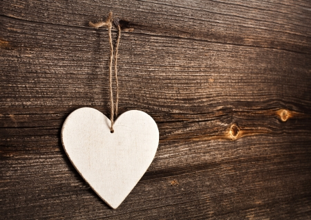 love message: Love heart hanging on wooden texture background, valentines day card concept Stock Photo