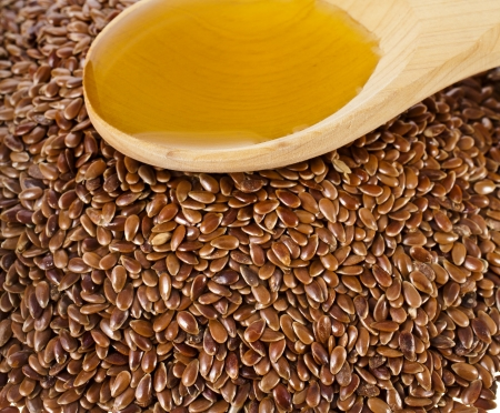 flax seed linseed and spoon oil closeup photo