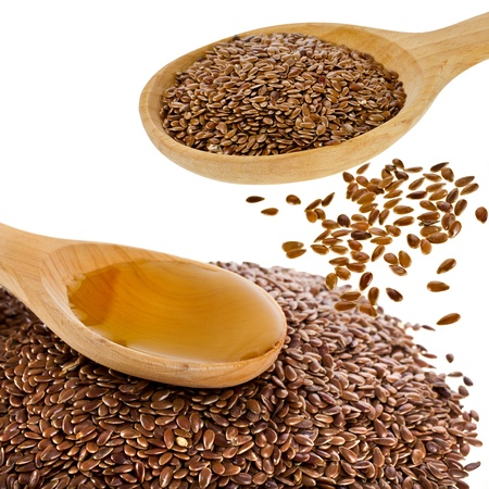 fatter: flax seed linseed and spoon oil closeup isolated on white background