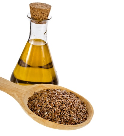 bottle flax seed oil isolated on white background photo