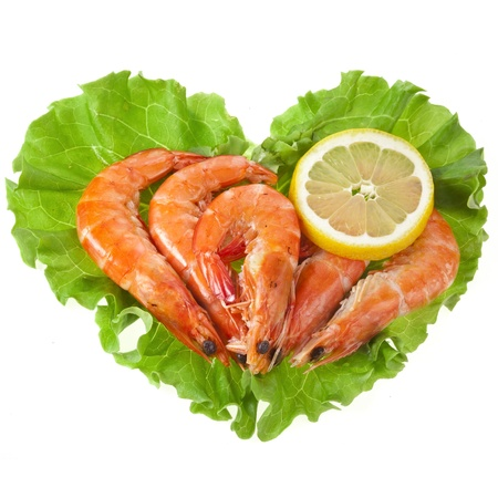 Heart healthy of fresh shrimp on a salad lettuce isolated on white background photo