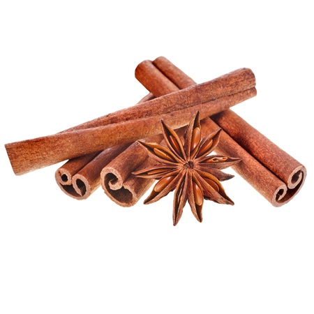 cinnamon sticks with whole star anise isolated on white background photo