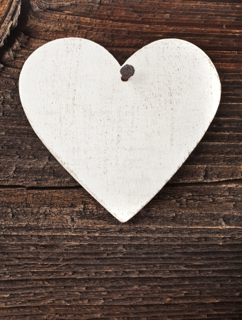 distressed wood: Love heart hanging on wooden texture background, valentines day card concept Stock Photo