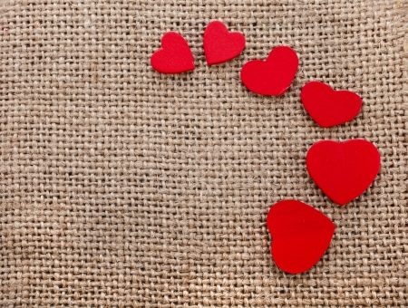 Border frame of red hearts on sack canvas burlap background texture Stock Photo - 18577406