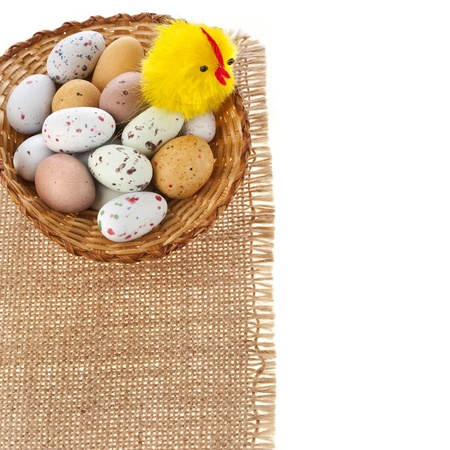 Basket with spotted egg , easter card on a white background Stock Photo - 18562940