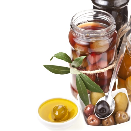 kalamata: Mixed pickled olives with spices on a white background Stock Photo