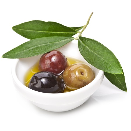 oilcan: Mixed pickled olives with different kind of olives in a bowl on a white background