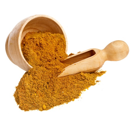 trituration: mortar with curry powder spice isolated on white Stock Photo