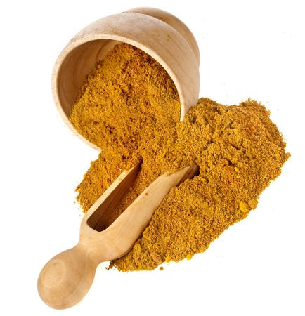 ocher: mortar with curry powder spice isolated on white Stock Photo