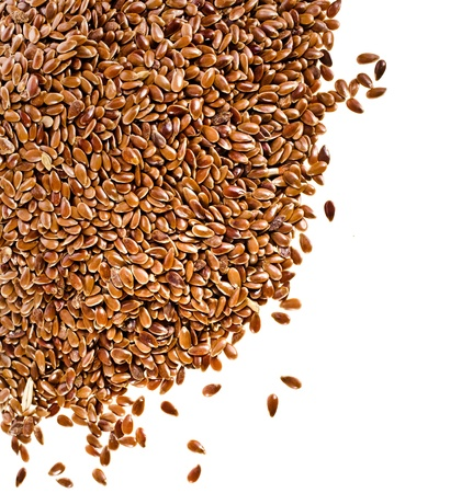flax: border of brown flax seed linseed closeup isolated on white background Stock Photo