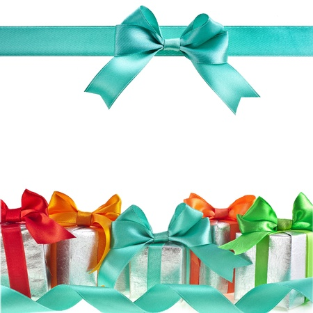 birthday backdrop: colorful gift boxes with bows isolated on white background