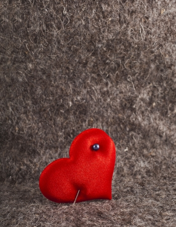 Heart symbol on wool felt texture with copy space Stock Photo - 18730921