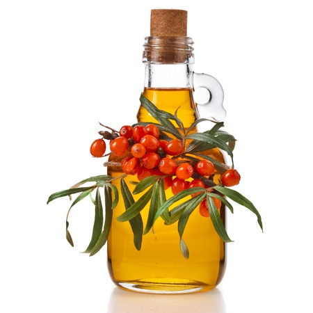 buckthorn: sea-buckthorn berries and oil glass bottle isolated on a white background Stock Photo