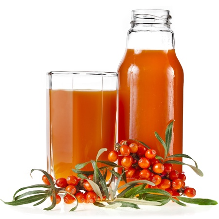 sallow: sea buckthorn berries juice on the glass bottle isolated on white background Stock Photo