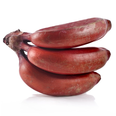 Bunch of dark red bananas over white background Stock Photo - 18870413