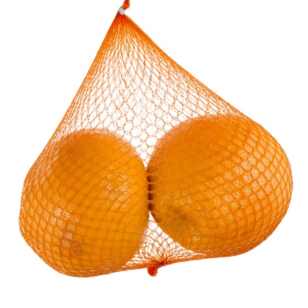 yellow grapefruits hanging in the mesh bag isolated on white background Stock Photo - 18870438