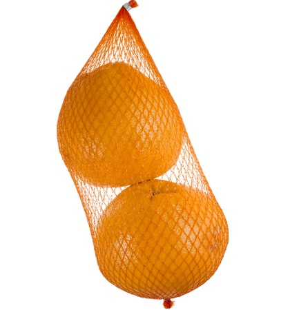 yellow grapefruits hanging in the mesh bag isolated on white background photo