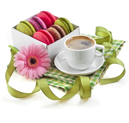 coffee cup with colorful macaroons in a table serviette isolated on a white background Stock Photo - 18932158