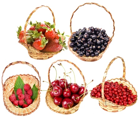 collection of ripe useful berries in the baskets, isolated on a white background photo