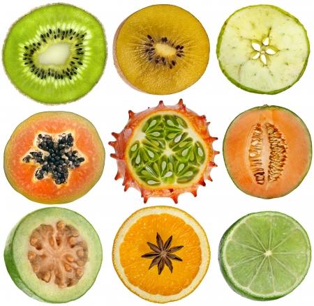 papaya tree: collection set of halves fruits kiwi, apple, papaya, kiwano, cantaloupe melon, guava, orange, lime close up isolated on white background