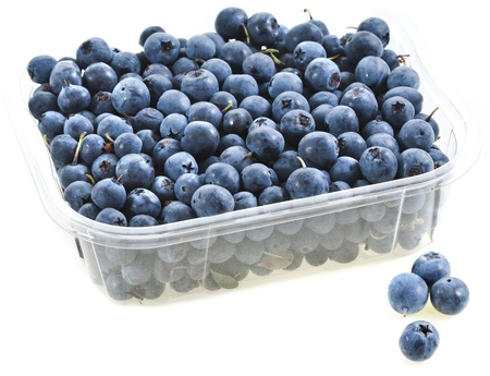 plastic box: sweet fresh blueberries in the plastic container isolated