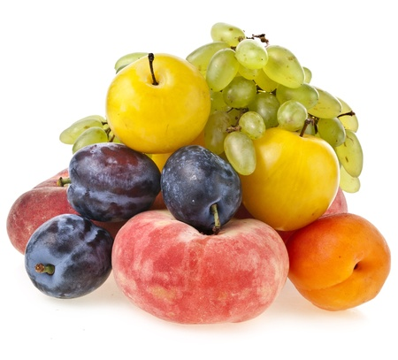 mixed fruits: mixed of fresh sweet fruits isolated on a white Stock Photo