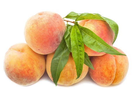 Peaches heap isolated on white background photo