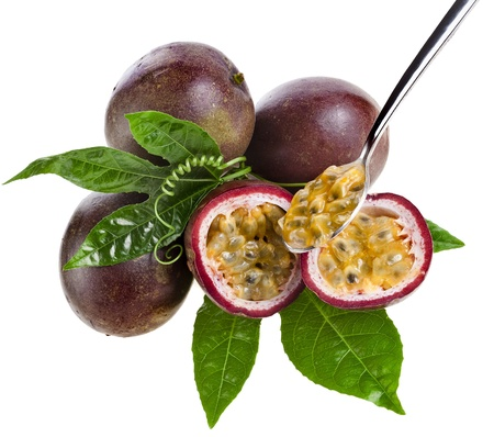 passion fruit: Passion fruit with tea spoon on a white background Stock Photo