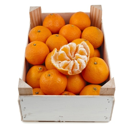 ripe orange mandarines in wooden box crate isolated on white photo