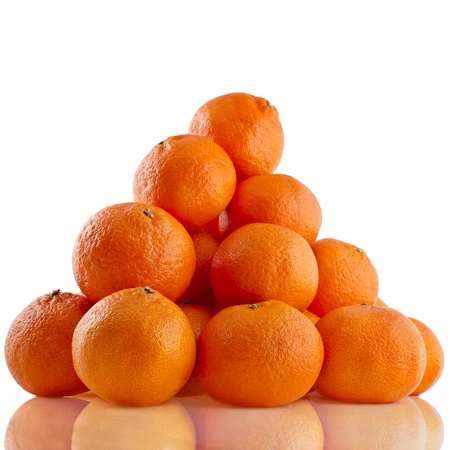 ripe orange mandarines heap pile close up isolated on white background photo