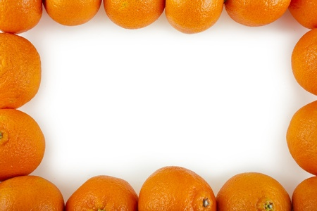 Border frame of orange tangerines isolated on white photo