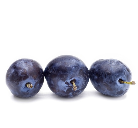 Three Plums isolated on white background photo